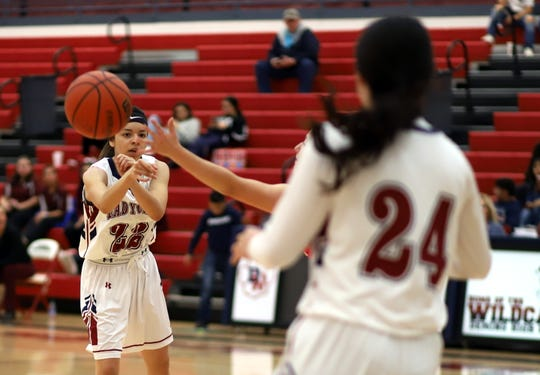 Junior Lady 'Cat Pillar Garcia (22) makes the extra pass that eventually led to a high-percentage shot during Friday'a 76-20 Lady 'Cats win over the Cobre High Indians.