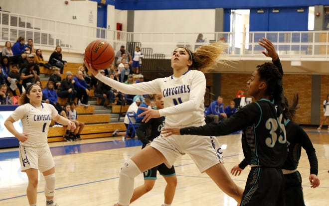 Carlsbad's Teran Tiller takes a contested layup against Oñate on Dec. 21, 2019. Carlsbad won, 48-41.