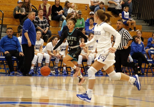 Oñate's Angel Jones starts a fastbreak while Carlsbad's Alexa Dugan races her down the court on Dec. 21, 2019. Jones led all scorers with 23 points but Carlsbad won, 48-41.