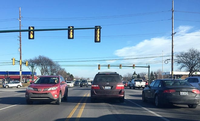 The intersection of Ford and Haggerty roads in Canton was busy as usual Sunday afternoon.