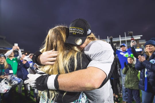 UWF offensive lineman Joe Wintrick celebrates a marriage proposal to his girlfriend Mackenzie Flynn after the Argos' national championship on Dec. 22, 2019.