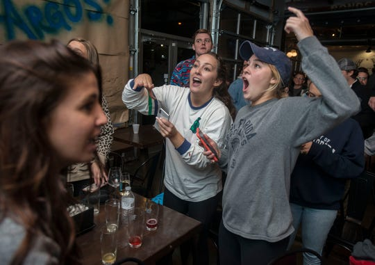 West Florida fans at Perfect Plain Brewery, react after the UWF football team won the Division II National Championship game against Minnesota State 48-40.