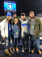 UWF assistant Kaleb Nobles (second from right) is joined by brother Kasey (right), sister Kenley (second from left) and former UWF volleyball player Katy Kuhlmeier celebrate UWF's national championship win over Minnesota State on Dec. 21, 2019 in McKinney, Texas.
