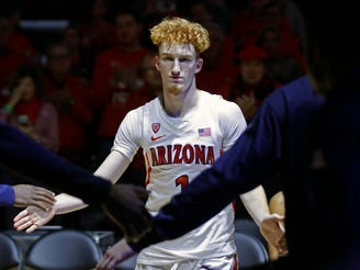 Dec 21, 2019; San Francisco, California, USA; Arizona Wildcats guard Nico Mannion (1) is introduced to the crowd before the game against the St. John's Red Storm at Chase Center. Mandatory Credit: Darren Yamashita-USA TODAY Sports