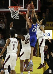Creighton's Christian Bishop (13) goes up against ASU's Romello White (23) and Alonzo Verge (11) during the second half at Desert Financial Arena in Tempe, Ariz. on Dec. 21, 2019.