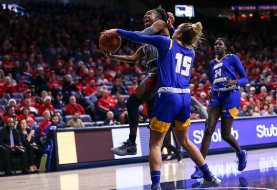 Arizona guard Aari McDonald heads toward the basket as UC Santa Barbara guard Tal Sahar tries to cut her off during the Wildcats' win at McKale Center. McDonald led all scorers with 21 points. She also had seven rebounds, seven assists and one steal.