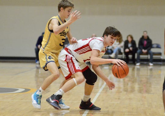 Port Huron's Ethan Balon dribbles during the Ed Peltz Holiday Tournament on Saturday, Dec. 21, 2019, at SC4.