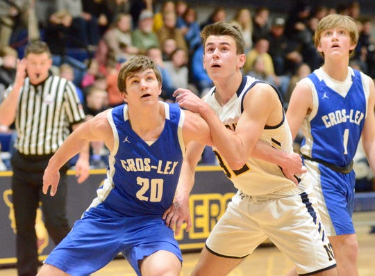 Croswell-Lexington's Jake Noll boxes out Port Huron Northern's Tyler Jamison during the Ed Peltz Holiday Tournament on Saturday, Dec. 21, 2019, at SC4.