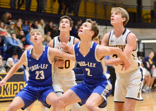 Croswell-Lexington's Hunter Soper boxes out Port Huron Northern's Ryan McNeill during the Ed Peltz Holiday Tournament on Saturday, Dec. 21, 2019, at SC4.