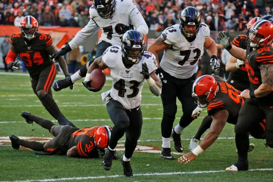 Baltimore Ravens running back Justice Hill (43) scores an 18-yard touchdown during the second half of an NFL football game against the Cleveland Browns, Sunday, Dec. 22, 2019, in Cleveland. (AP Photo/Ron Schwane)