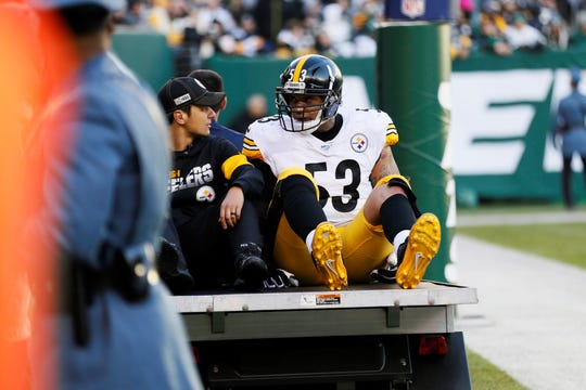 Pittsburgh Steelers center Maurkice Pouncey (53) leaves the field after being injured in the second half of an NFL football game against the New York Jets, Sunday, Dec. 22, 2019, in East Rutherford, N.J. (AP Photo/Adam Hunger)