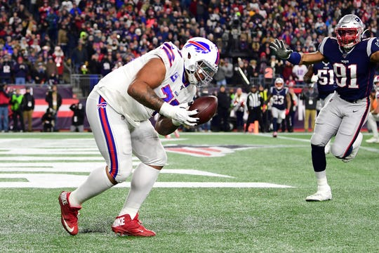 Dion Dawkins of the Buffalo Bills catches a touchdown pass during the second quarter against the New England Patriots in the game at Gillette Stadium on December 21, 2019 in Foxborough, Massachusetts. The catch pulled the Bills into a 10-10 tie at halftime.