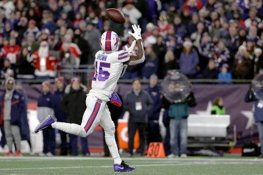 Buffalo Bills wide receiver John Brown, shown catching a touchdown pass at New England, established career highs for catches (72) and yards (1,065) this season.