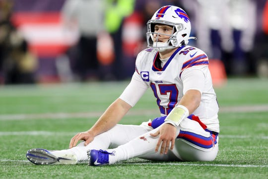 Josh Allen of the Buffalo Bills reacts after being knocked to the ground during the fourth quarter against the New England Patriots at Gillette Stadium on December 21, 2019 in Foxborough, Massachusetts. The Patriots defeat the Bills 24-17.