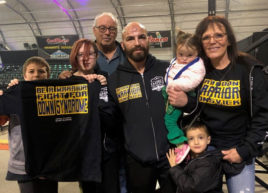 Brandon Honsvick (center) with his family after defeating Richard Demarsh at Mayhem in Mesquite XVIII on Dec. 21, 2019.