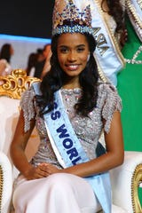 Winner of Miss World 2019, Toni-Ann Singh of Jamaica, front center, poses for photographers at the 69th annual Miss World competition at the Excel Centre in London Saturday, Dec 14, 2019, as 120 national representatives from around the world compete for the famous blue crown. Reigning Miss World, Vanessa Ponce de Leon from Mexico crowned her successor.