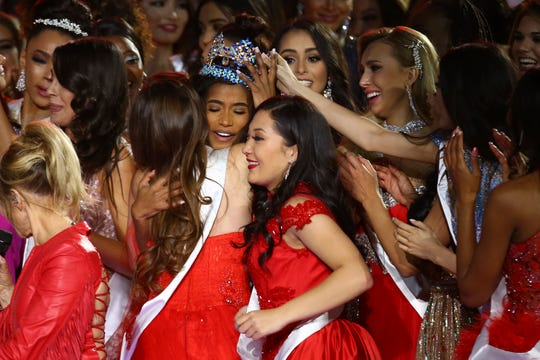 Winner of Miss World 2019, Toni-Ann Singh of Jamaica, center with crown, is congratulated by other contestants after winning the award, at the 69th annual Miss World competition at the Excel Centre in London Saturday, Dec 14, 2019, as 120 national representatives from around the world compete for the famous blue crown. Reigning Miss World, Vanessa Ponce de Leon from Mexico will crown her successor.