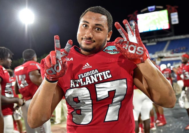 Florida Atlantic University defensive lineman Anthony Bennett (97) celebrates during the second half of the Owls' victory over Southern Methodist University in the Cheribundi Boca Raton Bowl at FAU Stadium in Boca Raton, Fla., on Saturday, Dec 21, 2019.