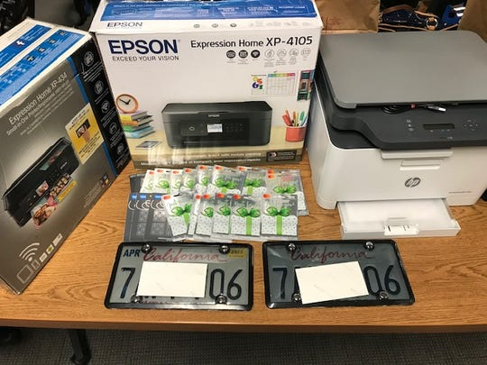 False license plates, prepaid gift cards and color printers were seized during an identity theft arrest in Bakersfield on Thursday, authorities said.