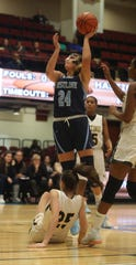 Ciara Croker of Ursuline goes to the basket after beating Luisa Scioscia of Hastings during a consolation game at the Slam Dunk Tournament at the Westchester County Center in White Plains Dec. 22, 2019. Ursuline defeated Hastings 83-45.