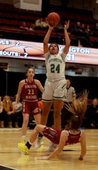 Samantha Bischoff of Albertus Magnus does down while defending Grace Thybulle during a consolation game at the Slam Dunk Tournament at the Westchester County Center in White Plains Dec. 22, 2019. Magnus defeated Irvington 60-33.