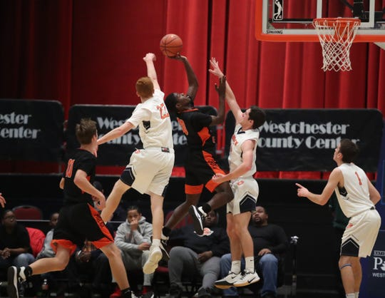 White Plains defeats Horace Greeley 69-37 in the opening round of the Slam Dunk Basketball Tournament at the Westchester County Center in White Plains on Saturday, December 21, 2019.