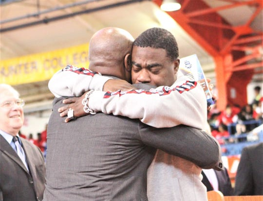 Comedian Tracy Morgan embraces DeWitt Clinton coach and New City resident Cornel Johnson during Johnson's Dec. 21, 2019 induction into The Armory Coaches Hall of Fame.