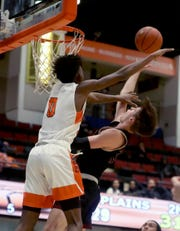 Will Harrington of Iona Prep is defended by Quion Burns of White Plains during a  championship game at the Slam Dunk Tournament at the Westchester County Center in White Plains Dec. 22, 2019.