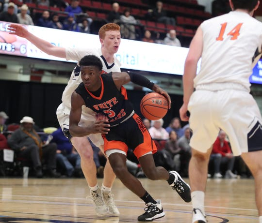 White Plains' Jayon Norwood (5) drives on Greeley's Will Lafortezza (22) in the opening round of the Slam Dunk Basketball Tournament at the Westchester County Center in White Plains on Saturday, December 21, 2019.