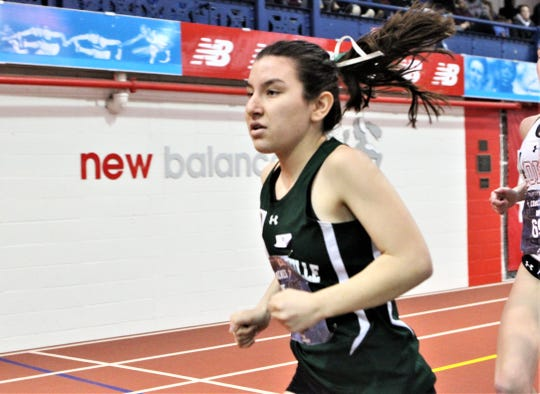Pleasantville's Adriana Catalano en route to a second-place finish in the girls invitational mile during the Dec. 21, 2019 Energice Coaches Hall of Fame Invitational at The Armory.