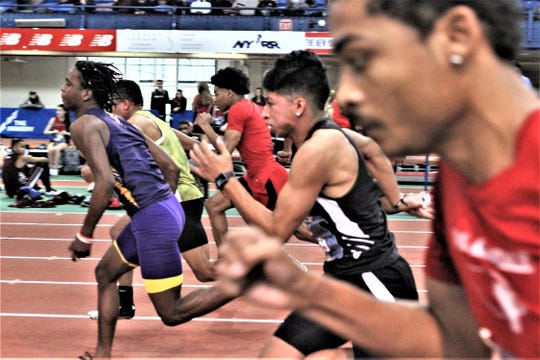 Nanuet's Fredy Martinez (in black) runs 6.84 for fourth place in the boys small-school 55-meter dash at the Dec. 21, 2019 Energice Coaches Hall of Fame Invitational at The Armory.