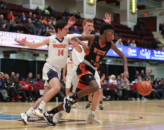 White Plains' Quion Burns (0) chases a loose ball as Greeley's Seth Brail chases in the opening round of the Slam Dunk Basketball Tournament at the Westchester County Center in White Plains on Saturday, December 21, 2019.