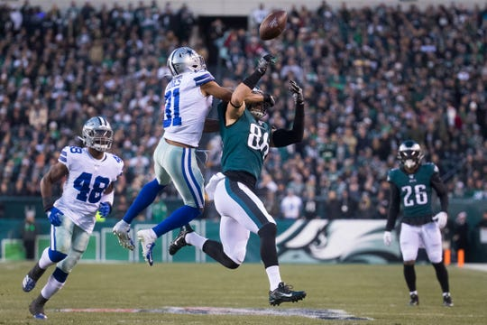 Eagles' Zach Ertz (86) is hit in the face by Dallas' Byron Jones (31) after failing to make a catch Sunday at Lincoln Financial Field.
