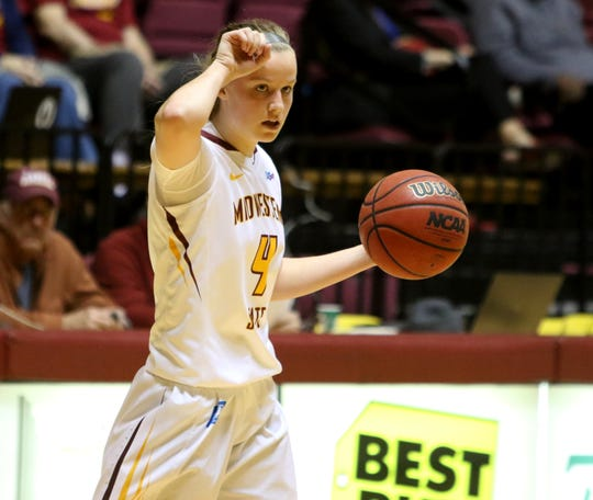 Midwestern State's Mica Schneider signals to her teammates in the game against Lubbock Christian Saturday, Dec. 21, 2019, at D.L. Ligon Coliseum.