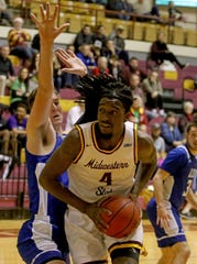 Midwestern State's Jalin Brown spins to the basket against Lubbock Christian Saturday, Dec. 21, 2019, at D.L. Ligon Coliseum.