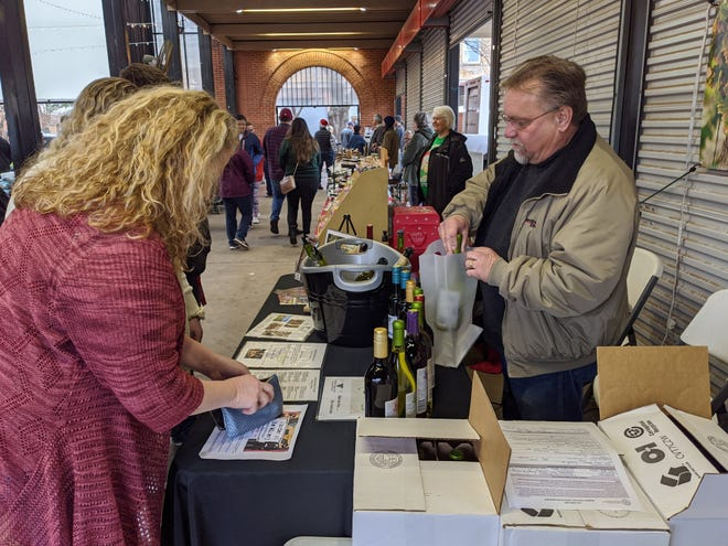 People stopped to shop for last minute gifts at the Downtown Wichita Falls Christmas Farmers Market Saturday, Dec. 21, 2019.