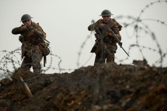"Blake (Dean-Charles Chapman, left) and Schofield (George MacKay) make their way through No Man's Land in ""1917."""