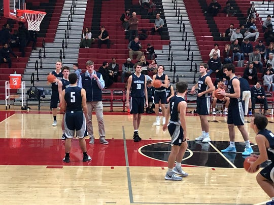 The Manasquan boys basketball team warms up just before the start of the second half at the Hoop Group Tip-Off  Showcase at the Thomas G. Dunn Sports Center at Elizabeth High School on Dec. 22, 2019.