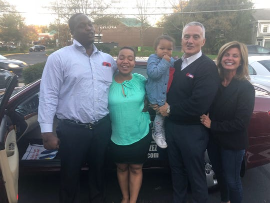 Left to right: Nicholas Johnson, Aniyyah Winkey-Lebron, their daughter Karen (center), and Paul and Chris Sansone in front of the Hyundai the Sansones donated.