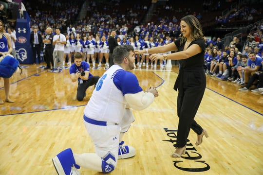 A guy in the Seton Hall Pirate mascot outfit -- not the regular mascot -- proposes to his girlfiend during a timeout.