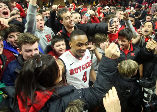 Rutgers guard Myles Mack is swarmed after the Scarlet Knight upset Wisconsin in 2015 at the RAC.