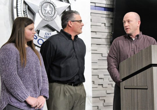 """""""Scott,"""" the father of a 5-year-old boy who fell into the Fairway Oaks spillway Saturday, offers his thanks publicly to Vince Viola, center, and his daughter Kate for their roles in rescuing the child. The father's last name was not given to protect the identity of his son."""