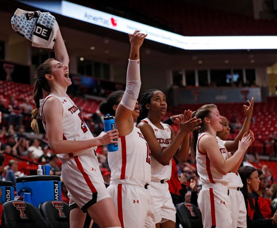 Brittany Brewer, left, and Texas Tech players celebrate during the non-conference game against Louisiana Monroe, Sunday, Dec. 22, 2019, in Lubbock, Texas.
