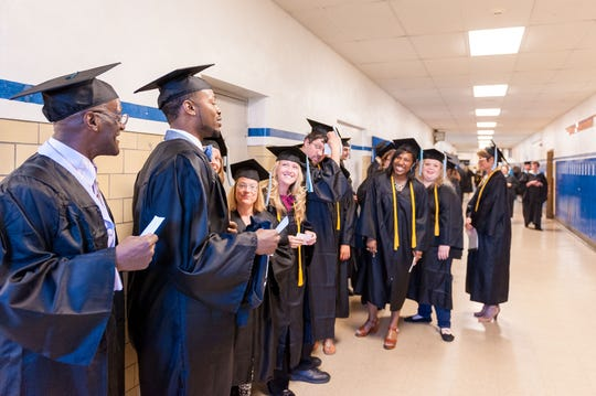 In this 2015 photos, graduates from Miller College appear excited to finish their commencement ceremony at Kellogg Auditorium.