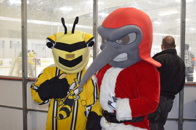 The Battle Creek Bombers mascot Mo Skeeter (or is that Santa Skeeter?) was on hand along with the Battle Creek Rumble Bees mascot B.B. Sting, on Bombers Night for the Rumble Bees game on Friday at The Rink.