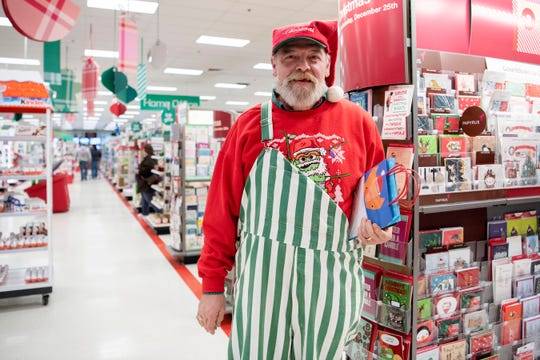 With only two days left until Christmas, Jay Ostrander buys presents for his wife on Monday, Dec. 23, 2019 at the Target on Beckley Rd. in Battle Creek, Mich.
