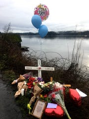 A memorial at the site of Fjord Drive honors Shane Larson, who died Dec. 15 at a Tacoma hospital a day after he was rescued from his submerged car in Liberty Bay.