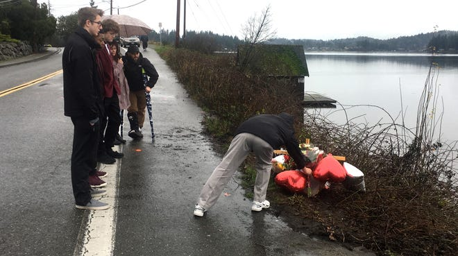 Family and friends of Shane Larson gathered on Saturday at the site on Fjord Drive in Poulsbo where the car he was driving went into Liberty Bay on Dec. 14. Larson, 19, died Dec. 15 at a Tacoma hospital. His fiancee Alison Lenz, 20, survived after Larson pushed her from the submerged car.