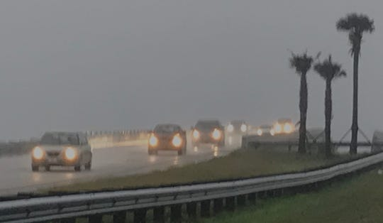 Motorists on the Pineda Causeway ran into rain during the morning commute Dec. 23, 2019.