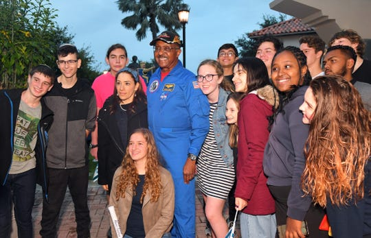 Former NASA astronaut Winston Scott poses with several students from Israel and the United States. Chabad of the Space & Treasure Coast in Satellite Beach held their annual Chanukah Parade on Sunday, which was followed at Cocoa Riverfront Park for the Music Festival that included helicopter gelt drop, the lighting of the Menorah, and a concert starring Hassidic rapper Nissim Black.